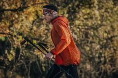 Young man runner running marathon walking sticks Stock Photos