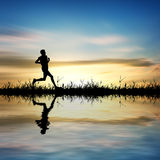 Young man runner silhouette Stock Photography