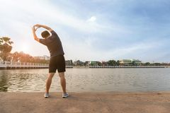 Young man runner stretching and exercise healthy lifestyle. royalty free stock images