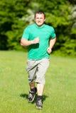 Young man running Stock Photos