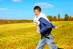 Young man running Royalty Free Stock Photos