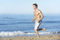 Young Man Running Along Summer Beach Royalty Free Stock Photos