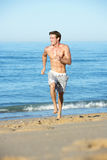 Young Man Running Along Summer Beach Royalty Free Stock Images
