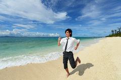 Young man running on the beach Royalty Free Stock Photography