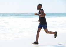 Young man running exercise on the beach Stock Photo