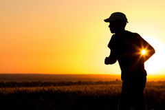 Young man running in the field Royalty Free Stock Image