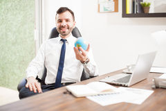 Young man running a global business Royalty Free Stock Image