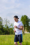 Young man running and jogging on road in country Royalty Free Stock Images