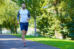 Young man running in the morning. Full length shot of a youung man running outdoor Royalty Free Stock Photography