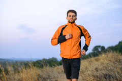 Young Man Running Outdoor on the Trail in the Park. Active Lifestyle. Concept Stock Images