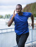Young man running outdoors Royalty Free Stock Photo