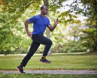 Young man running outdoors Royalty Free Stock Image
