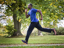 Young man running outdoors Royalty Free Stock Photography