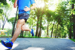 Young man running outdoors stock image