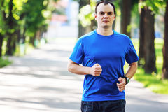 Young man running outdoors Stock Images