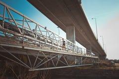 Young man running over metal bridge Royalty Free Stock Photo