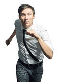 Young man running over white background Royalty Free Stock Images