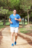 Young man running in park Stock Photography
