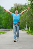Young man running through park Royalty Free Stock Photo