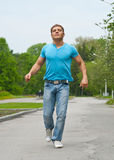 Young man running through park Royalty Free Stock Image