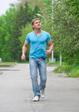 Young man running through park Royalty Free Stock Photos