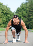 Young man running in park Royalty Free Stock Images