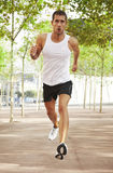 Young man running in the park Royalty Free Stock Photos