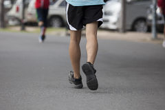 Young man is running in the park. Royalty Free Stock Image