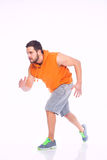 Young man in running position Royalty Free Stock Images