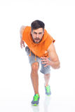 Young man in running position Royalty Free Stock Image