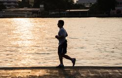 Young man running on the river stock photos