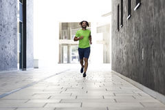 Young man running on the street in urban environment Royalty Free Stock Photography