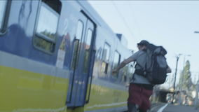 Young Man Running to the Train stock footage