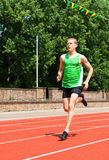 Young Man Running on Track Royalty Free Stock Photo