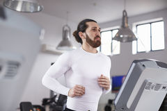 Young Man Running On Treadmill In Gym Stock Photos