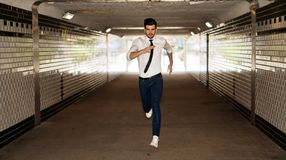 Young man running through underpass. Young businessman running through underpass Stock Photos