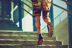 Young man running up the stairs outdoor in the city Stock Photo