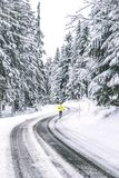 Young Man running on the winter road stock image