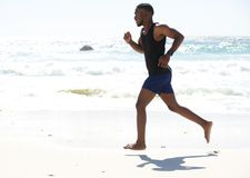 Young man running work out at the beach Royalty Free Stock Image