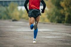 Young man runs marathon Stock Photo