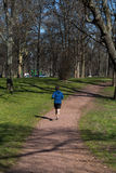 Young man runs through the Park Royalty Free Stock Photography