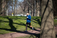 Young man runs through the Park Royalty Free Stock Image
