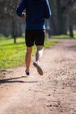 Young man runs through the Park Royalty Free Stock Photos