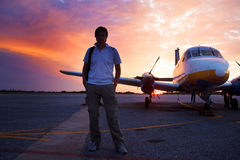 Young man on the runway in background of a small Stock Photos