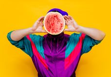 Young man in 90s clothes with watermelon stock image