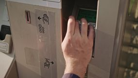 Young man`s hand using ATM stock video footage