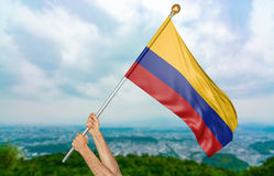 Young man`s hands proudly waving the Colombia national flag in the sky, part 3D rendering Royalty Free Stock Images