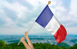 Young man`s hands proudly waving the France national flag in the sky, part 3D rendering Stock Images