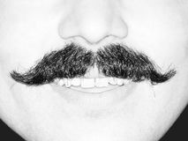 Young Man's Moustache. Black and white closeup of the moustache of a smiling young man.  Only lower part of face is shown Royalty Free Stock Photos