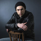 Young man's portrait. Atractive young man sitting at a chair Royalty Free Stock Photos